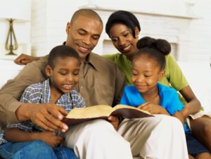 parents and their children reading the bible